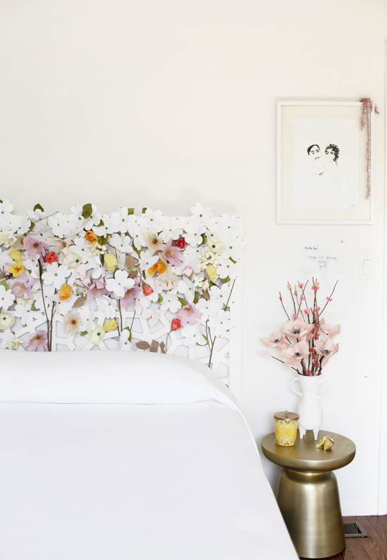 Here's a quick way to update your headboard without buying a new one. Faux flowers weaved into the headboard, found on Design Love Fest.