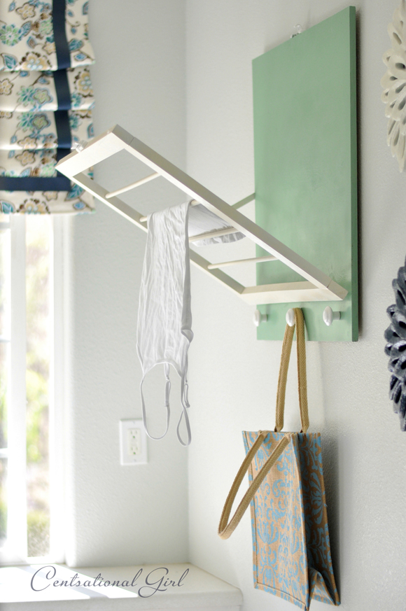 This is one of my favorite laundry room DIYs. We have no where to hang clothes to dry in our home, so this is perfect. It's folds up into the wall when you don't need it. Found on Centsational Girl.