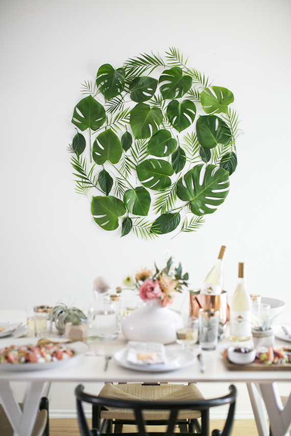 Use what you can find in your backyard. This leaf backdrop is perfect, from Almost Makes Perfect.