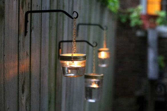 Hanging mason jar lantern lights, from 17 Apart.