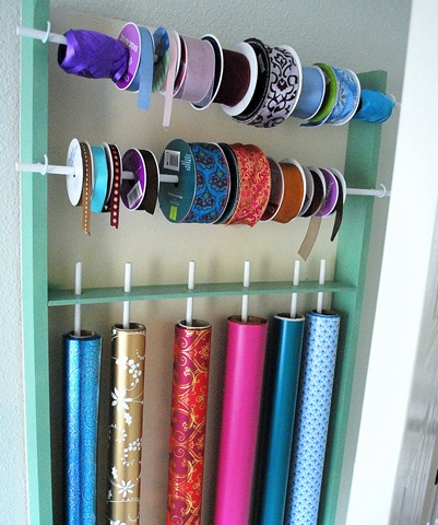 With the big holiday season coming to an end I bet you have a ton of wrapping paper to organize. Check out this cool wrapping paper and ribbon station, from Centsational Girl.
