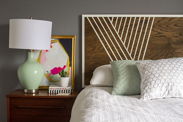 Make this headboard with birch wood, trim, and paint. The DIY can be found on eHow (created by Dream Green DIY).