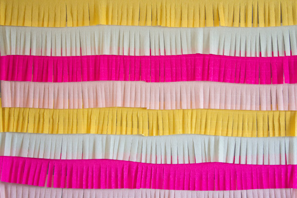 Turn your crepe paper into fringe garlands to create this colorful set up, from Lovely Indeed.