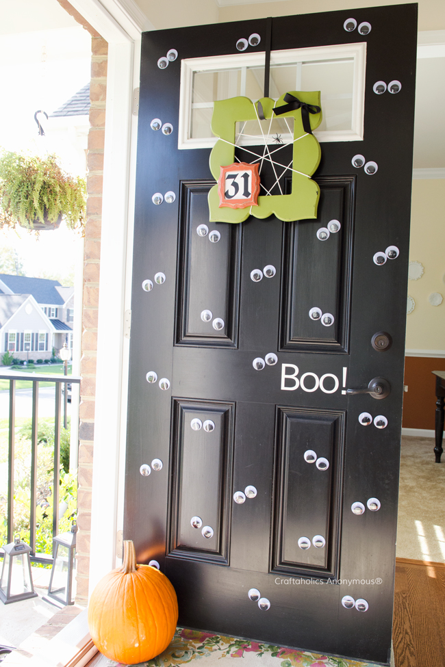 Use some removable sticky dots to attach large googly eyes to your door, on Craftaholics Anonymous.