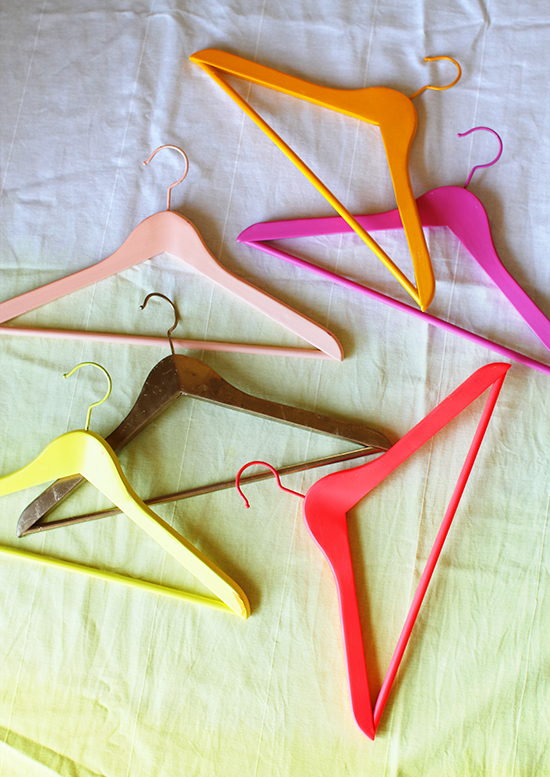 Spray paint your hangers different colors to organize your clothes! Hanger found on Design Love Fest.