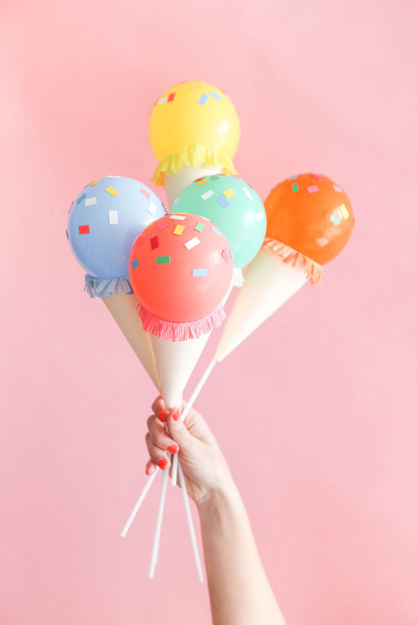 Make these cute ice cream balloons on a stick for your summer party! Found on Oh Happy Day.
