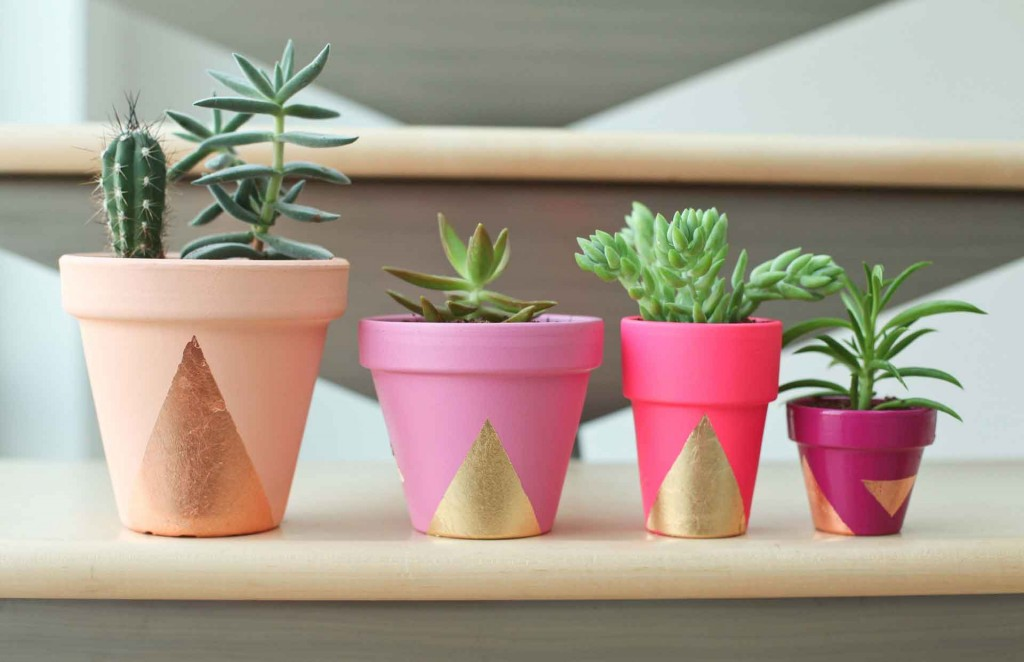 For the garden lover, makeover some plain pots with bright paint and add a succulent, from Miss Renaissance.