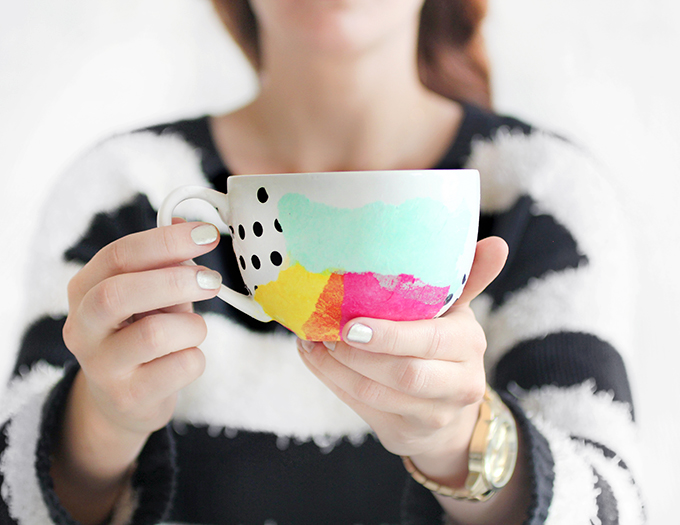 Using colorful and graphic tissue paper will brighten up any mug, via I Spy DIY.