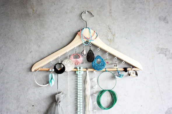 Transform a wooden pants hanger into a jewelry organizer. You'll just need the wooden hanger, screws, and some eye hooks. Found on Morning Creativity.