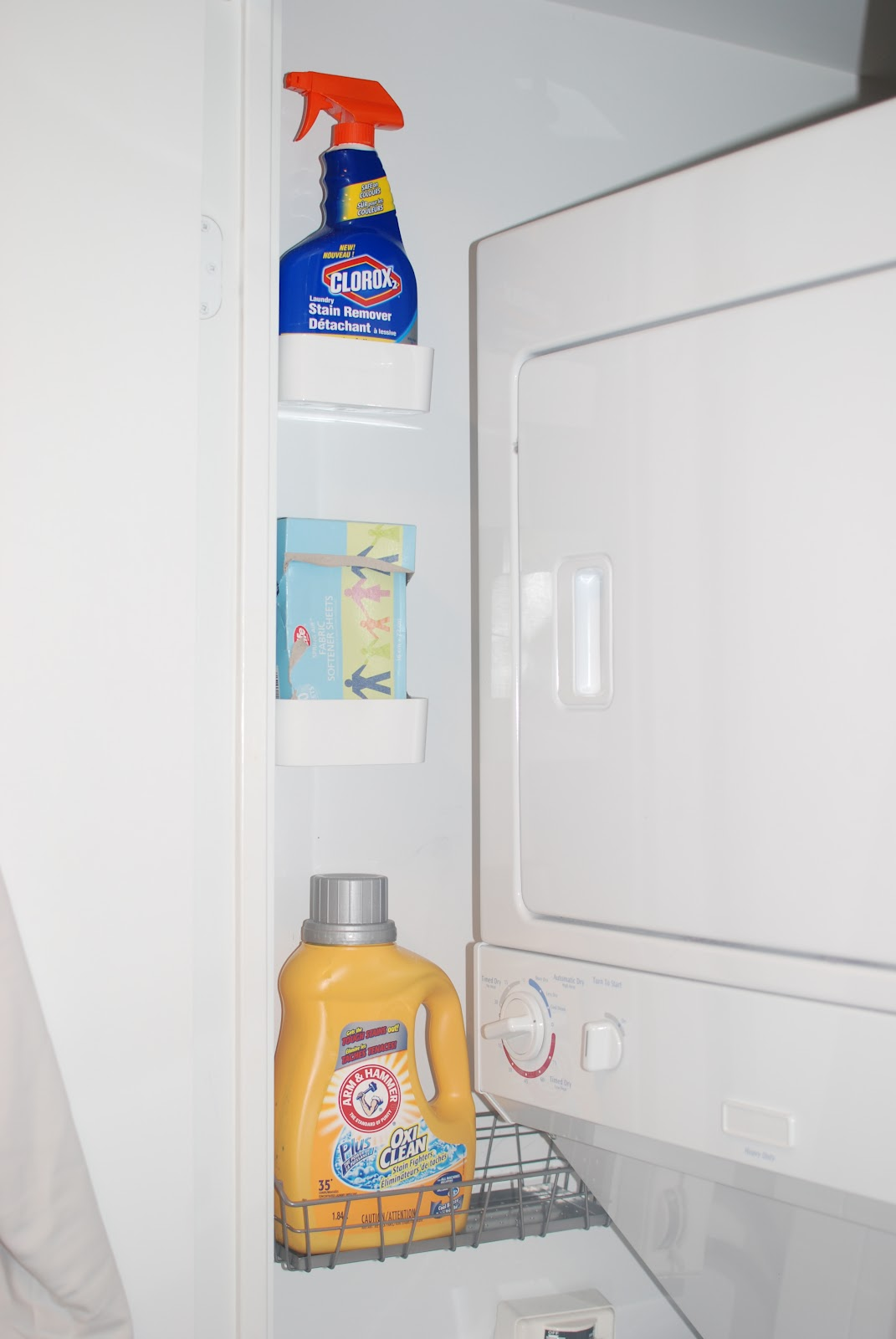 I love that this clever person really used the small space that she had. Tiny shelves hold the items she needs easy access to while doing laundry. Found on Waffling Blog.