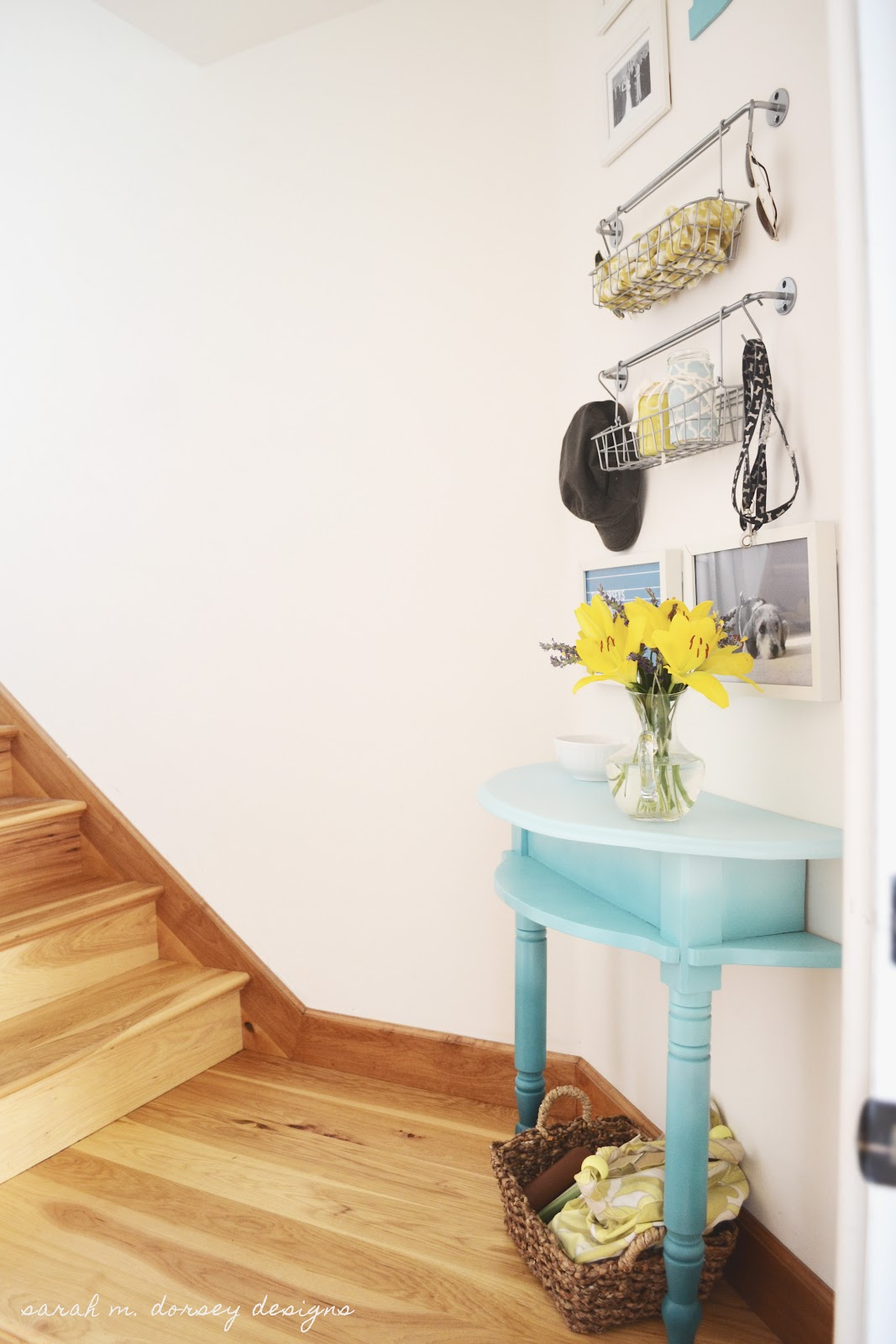 Do you have a small entryway? This entry table was cut from a larger table and I love it, from Sarah M. Dorsey Designs.