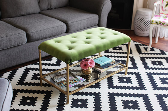 This beautiful ottoman coffee table was made from a plain IKEA coffee table. She goes into great detail on how to tuft this pretty thing. Check it out on Melodrama.