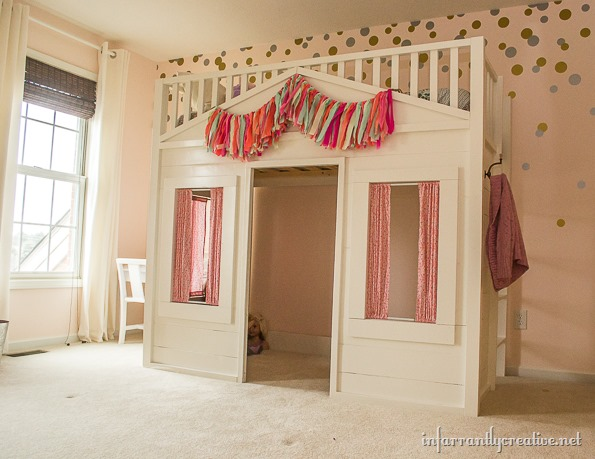 This bunk bed doubles as a sleeping spot and play place! Find the tutorial on Infarrantly Creative.