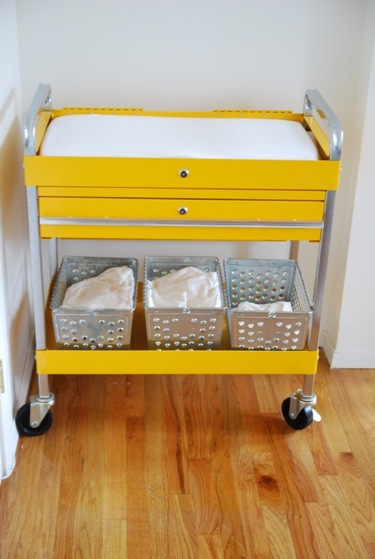 This changing table is actually a rolling tool cart… so cool. Just roll this thing around as you need it, from Apartment Therapy.