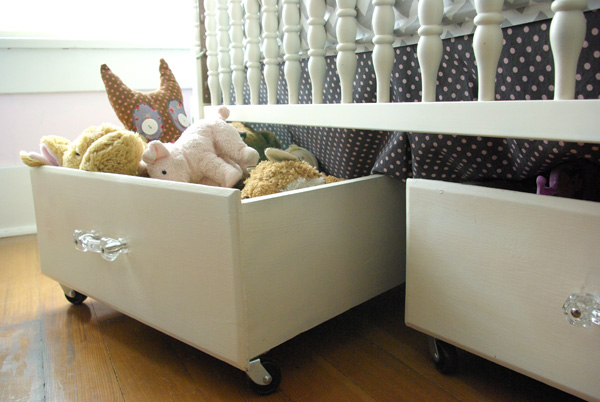 Add wheels to some old drawers and they can sit under the crib full of toys, from Oleander and Palm.