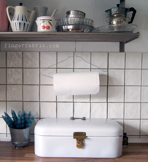 A wire hanger will also make the perfect paper towel holder! Found on Fingerfabrik.